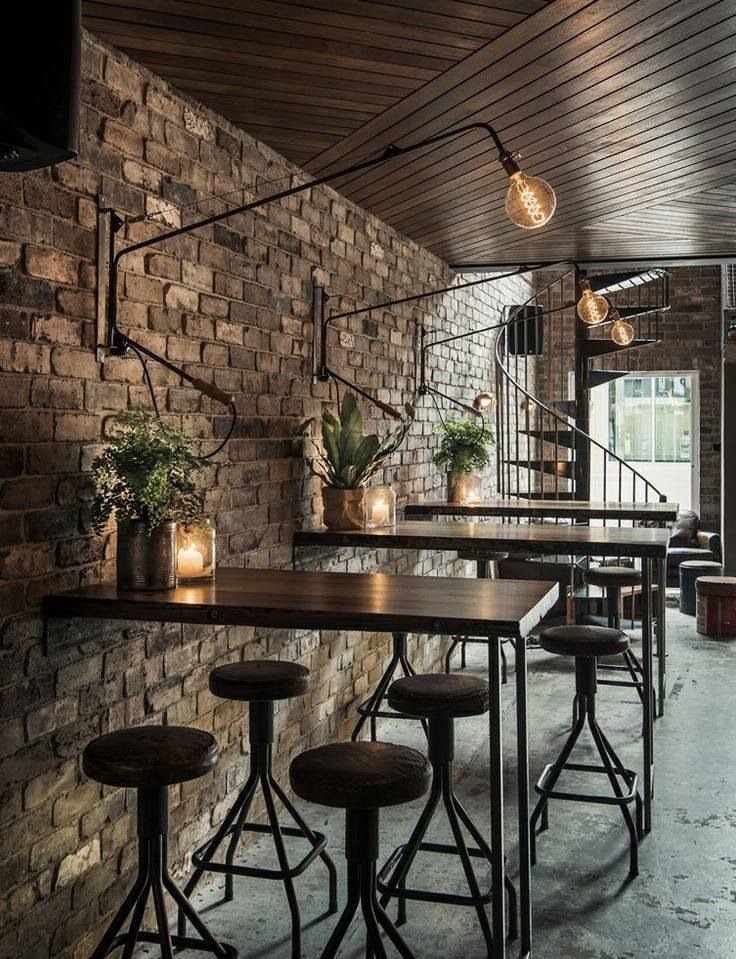 wood ceiling, polished concrete foor, exposed brick wall, light fixtures.... wonderful mix