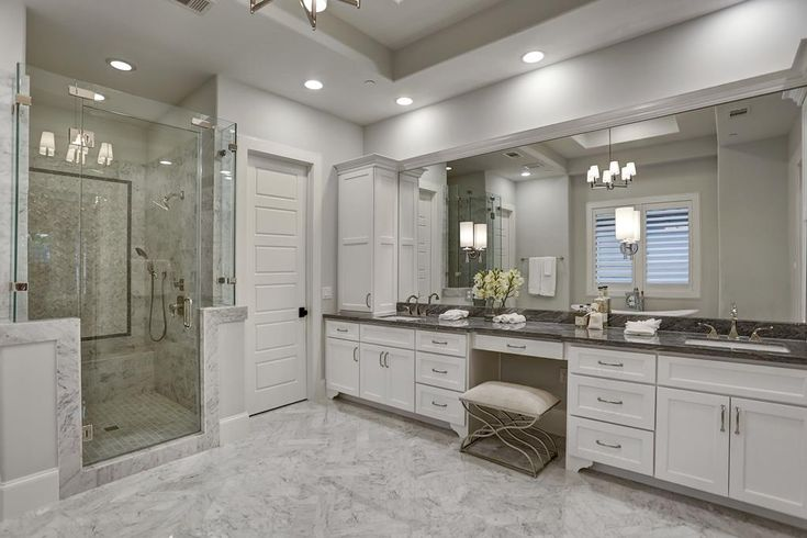 4931 Willow Street, Bellaire, TX 77401: Photo Master bath features Bardigo Marble counters with double sinks and a separate vanity area and Carrera Marble floors with Herringbone pattern.