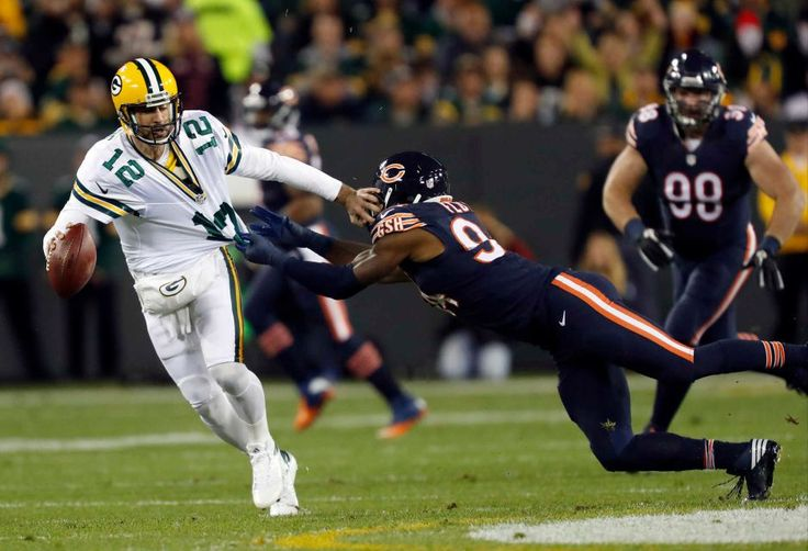 Thursday Night Football: Bears vs. Packers  -  October 20, 2016  -  26-10, Packers  - Green Bay Packers quarterback Aaron Rodgers (12) tries to runs away from Chicago Bears outside linebacker Leonard Floyd (94) during the first half of an NFL football game, Thursday, Oct. 20, 2016, in Green Bay, Wis.