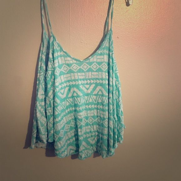 Light blue tank top Light blue tribal print crop top tank top. Never worn Charlotte Russe Tops Crop Tops