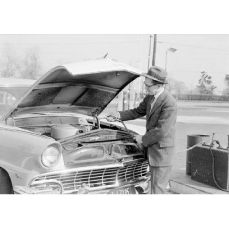 Man pouring water in car radiator Canvas Art - (18 x 24)