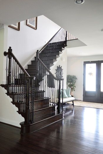 House Crashing: Four A Good Cause | Young House Love  Dark staircase, dark wood floors, creamy walls.