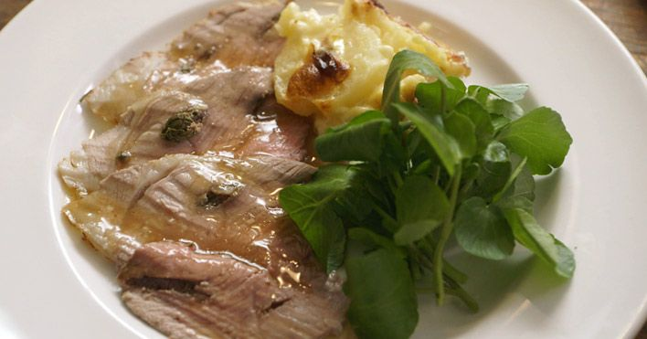 Roast Lam with anchovy, rosemary and garlic served with an amazing Gratin de Jabron