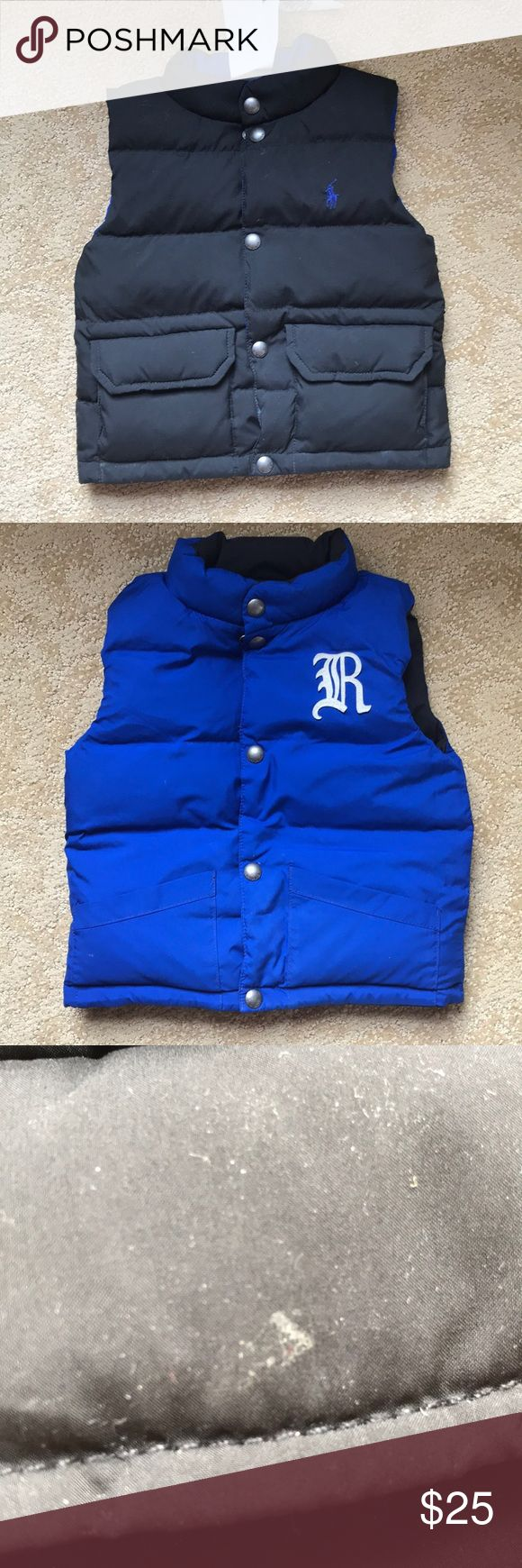 Reversible little boy puffy vest Lack side and a blue side.  Black side with some small spots that appear they would wash out( last photo)  but haven't tried.    The tag with the size on it is gone but I believe it's 12-18 Months.  My son wore it when he was 1 year and he was on the larger side. Polo by Ralph Lauren Jackets & Coats Vests