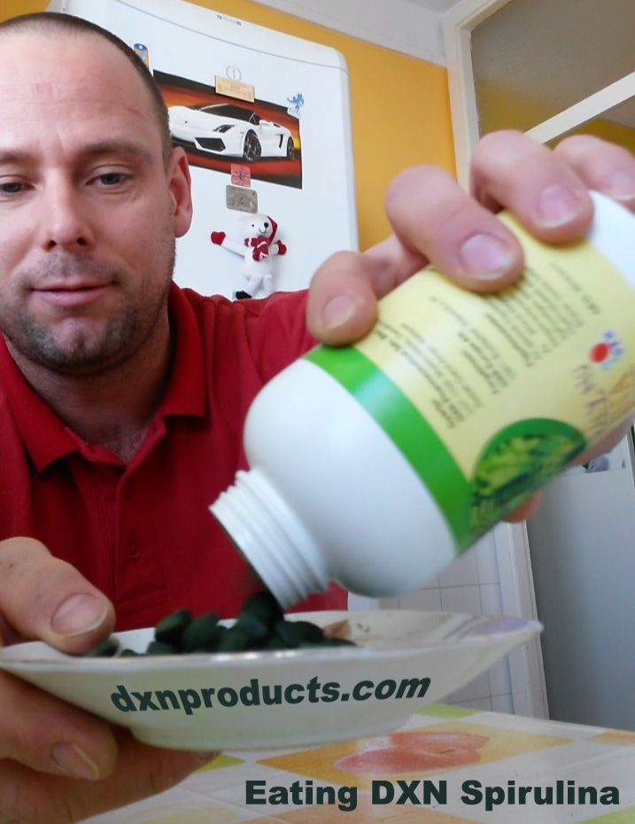 Gergely Takács, DXN, presenting Spirulina superfood and eating his daily dosage of 10 tablets.