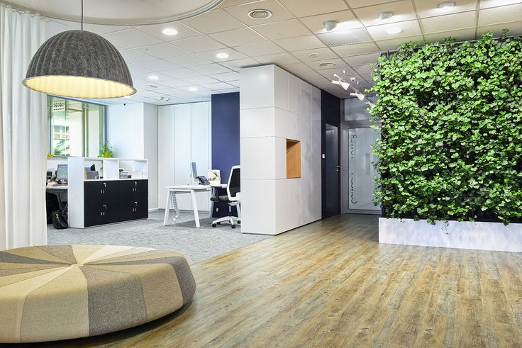 office interior by idstudio, by the entrance a green wall, lamp from Muuto