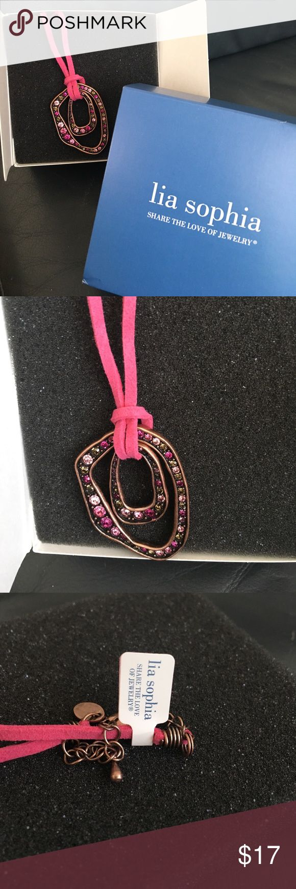 NWT Lia Sophia pink necklace NWT Lia Sophia pink gem necklace with copper tones and pink suede cord.  Very cute piece for a summer accent! Lia Sophia Jewelry Necklaces