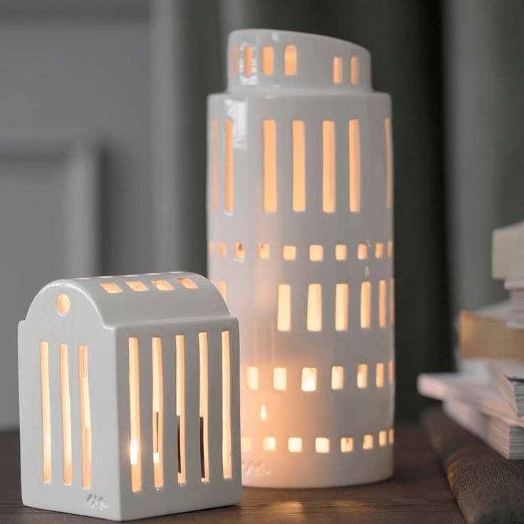 Kahler Urbania Tarn light house is a tall, round tower is inpired by our creative modern buildings and silhouettes popping up in our cities. Each Tarn light house has individually cut windows for its own unique look. Tarn will glow beautifully and will look great grouped with othe Urbania light houses. It comes gift boxed so a perfect present. http://bit.ly/2BbadkQ