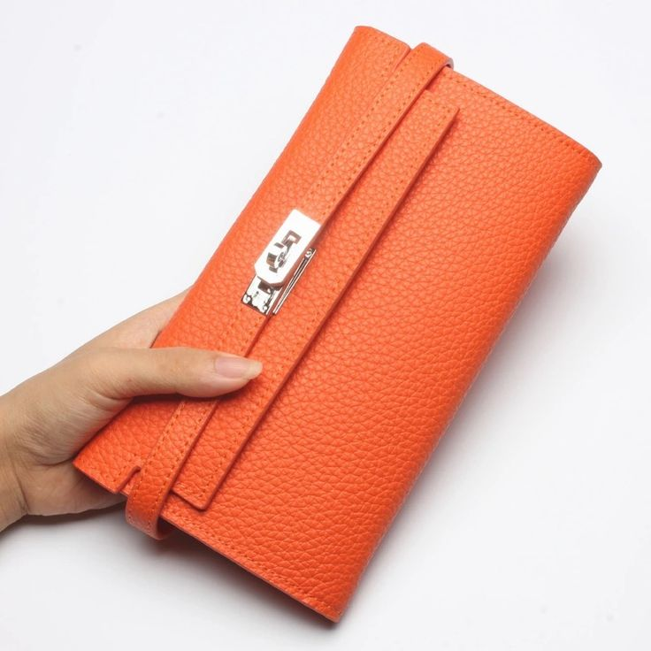 Order from me unbranded designer inspired Kelly wallet in genuine high quality cow leather, silver hardware classic orange £125. Email sarah@west-ten.co.uk.