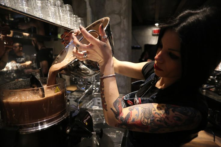 Barista in chocolate machine