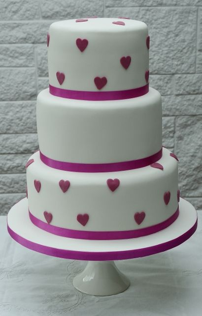 A simple design with striking fuschia coloured hearts.