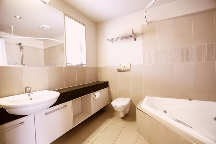 Our most popular! And you will see why, super-spacious Executive Studio. 'Beautifully appointed upmarket Italian living'. King-size bed. Full kitchen facilities including granite breakfast bar, dishwasher, water filter and granite bench-top. Work station for the Business Traveller (Broadband/wireless internet), Fax/Phone, LCD TV, SKY GUEST SELECT 50+ CHANNELS, CD sound system, DVD player. Large double corner spa bath in bathroom. AirCon/HeatPump.Balcony