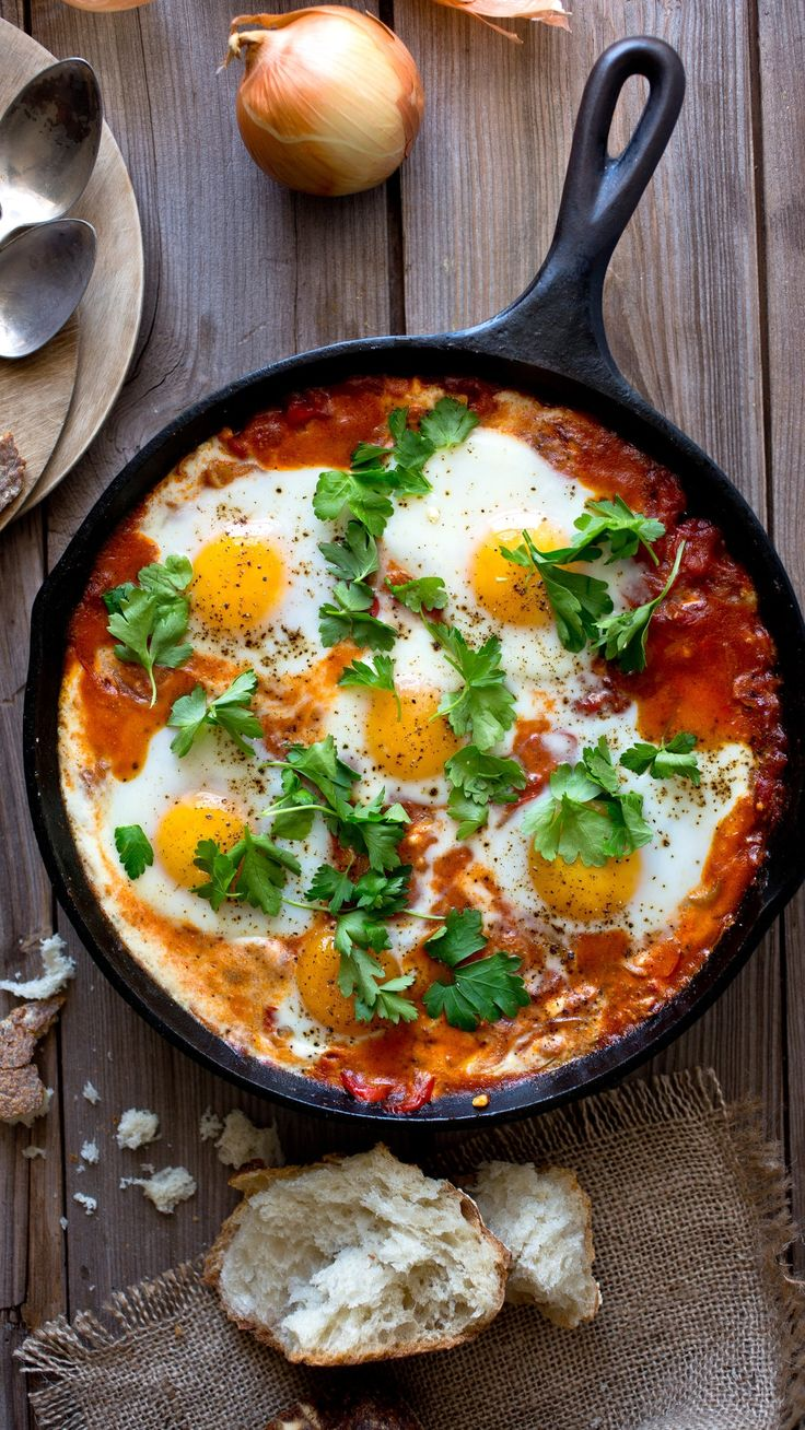 Shakshuka may be at the apex of eggs-for-dinner recipes, though in Israel it is breakfast food, a bright, spicy start to the day with a pile of pita or challah served on the side (It also makes excellent brunch or lunch food.) (Photo: Andrew Scrivani for The New York Times)