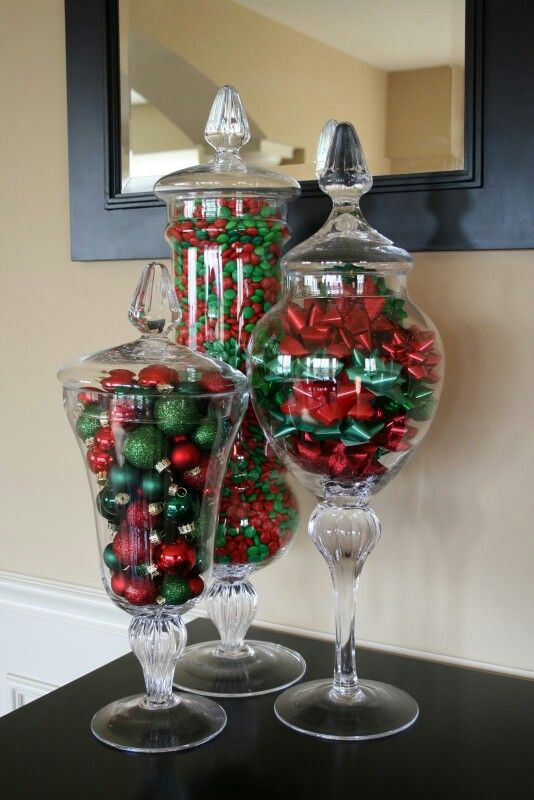 To help keep the costs lower on a candy buffet but keep the look - add Christmas bows and baubles to jars beside the candy jars.