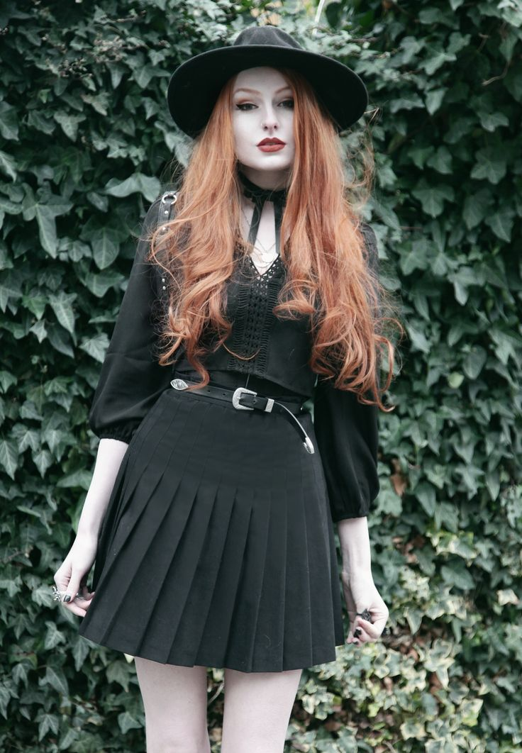 Olivia Emily wears Asos folk crop top, Valfre Bowie choker, American Apparel pleated skirt and YRU Aura boots