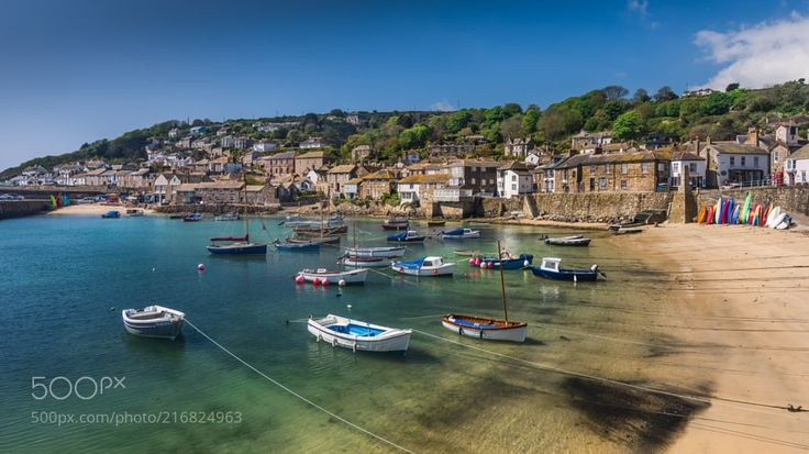 """Mousehole by Mark_Lawson from http://500px.com/photo/216824963 - In May for my own amusement I decided to walk the South West Coast Path between Lizard & Mousehole in Cornwall. Mousehole is a small village just to the west of Penzance. The village is built around a small circular medieval stone walled harbour.... """"The Mousehole"""". Cornwall. UK.. More on dokonow.com."""