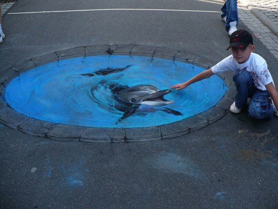 3-D Dolphin art by Street Advertising Services (SAS) in London, England - photo from Hongkiat