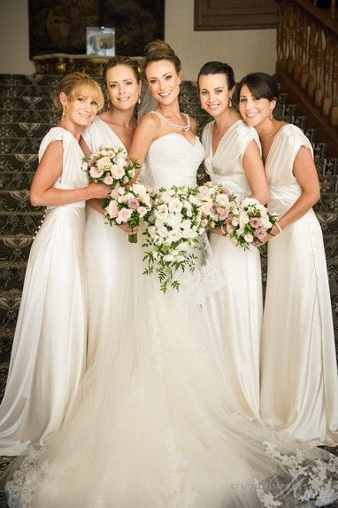 Stunning cream bridesmaid dresses ~ would prefer if wedding gown was a champaign color. I Do Bridal galena, ATOS!