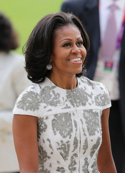 Michelle Obama Medium Layered Cut     Choppy layers made MObama's hair looked light and full of volume.