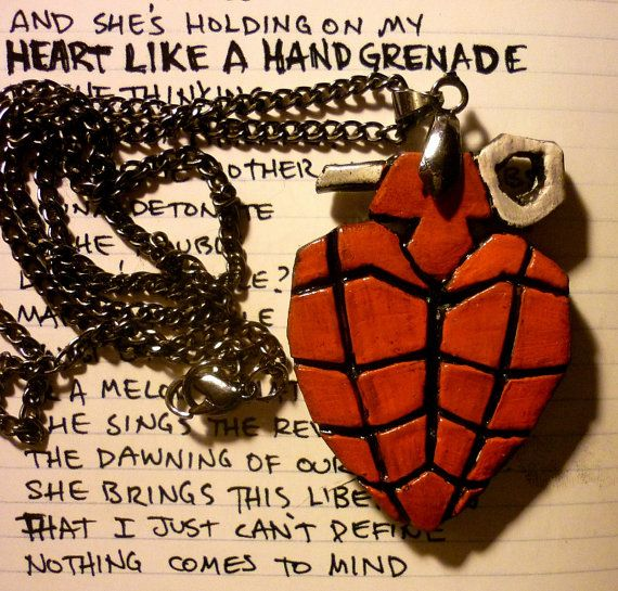 green day's AMERICAN IDIOT heart grenade polymer clay by snooeisen I will wear this as a necklace!