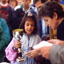Little Marion Bartoli receiving a trophy