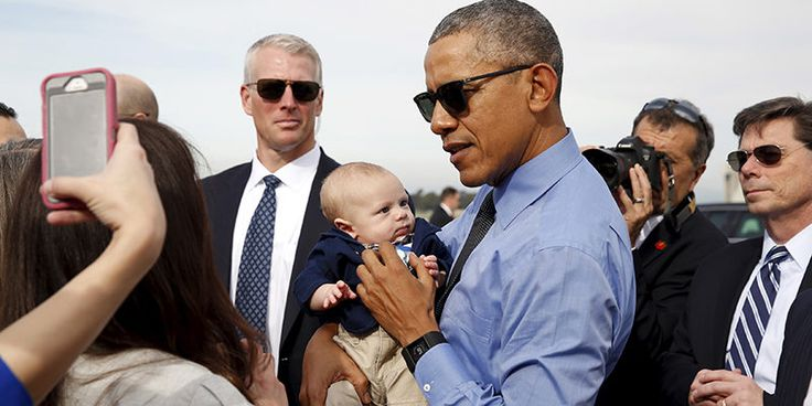 US President Barack Obama holds a baby