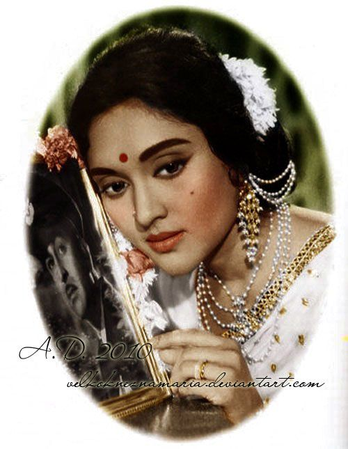 Vyjayanthimala - isn't she just too gorgeous?! Check out the classic white Saree with gold border.