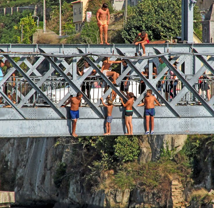 Kids jumping to the river Douro, Porto.