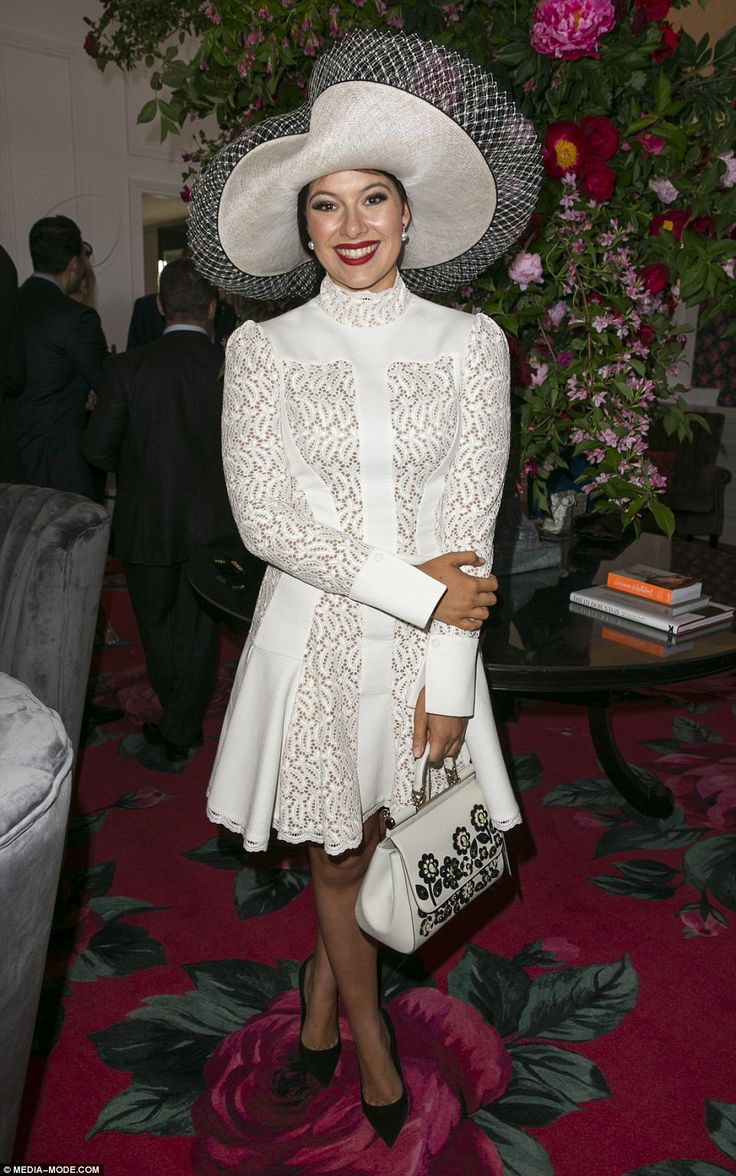 Racy in lace: Francesca Packer Barhamstepped out in a frilly white design and oversized h...