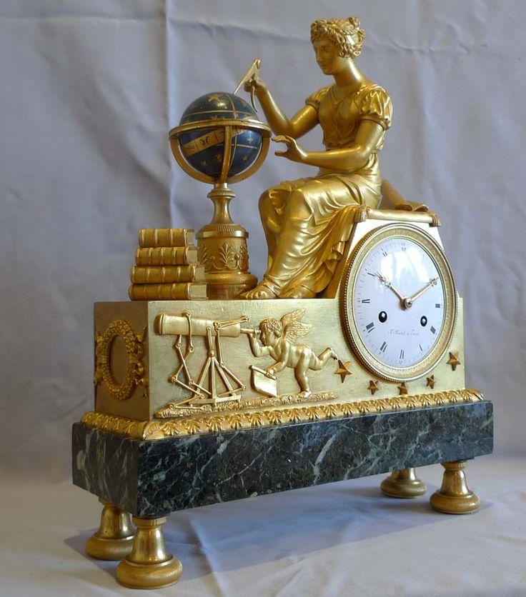 Antique French empire clock. Ladies-in-action.