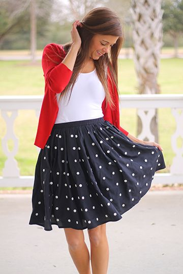 "This skirt is absolutely precious! Polka dots are one of our favorite patterns, and this full bodied skirt will look great with a plain tank or a button down tucked in. Miranda paired hers with a plain white top and a red cardigan... it plays up on the nautical trend that's huge this season! Fits true to size. Miranda is wearing a small. from waist to hem: small=20.5"" medium=21 large=21.5"