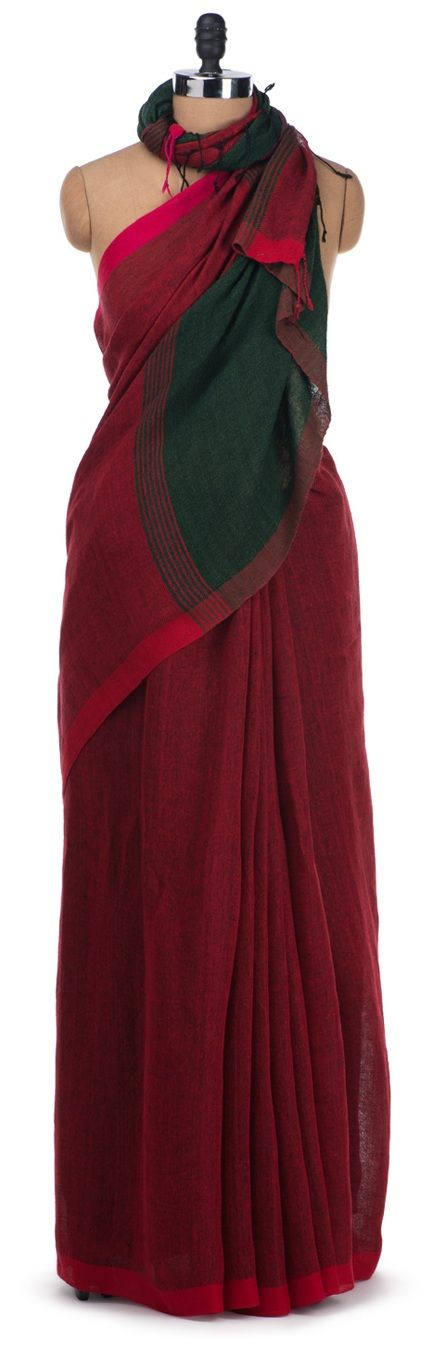 Stunningly simple, yet so appealing twisted linen handloom saree makes a statement with its bold red and dark green combination. Like it or Love it?