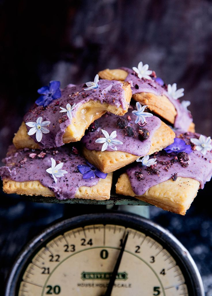 Celebrate spring (and breakfast time) with homemade lemon curd pop tarts topped with a natural blueberry icing and edible flowers!