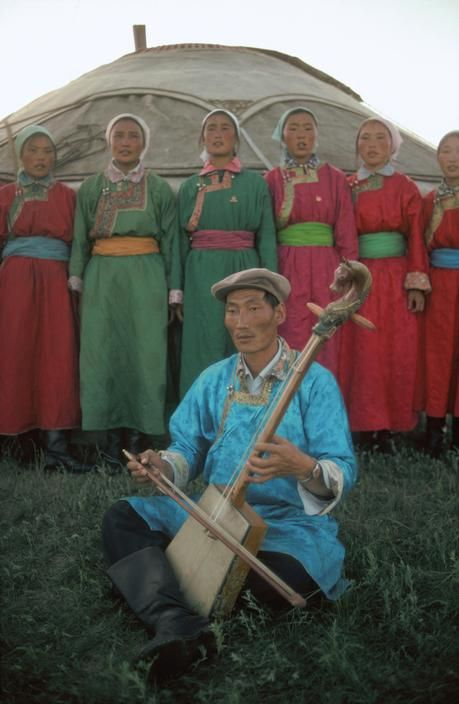 China. Militia of Golden River White Horse Company singing a folk song. 1979.
