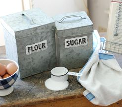 Galvanized Flour and Sugar Canisters, Cotton Wreath, White Enamel Measuring Cups, Wicker Trunk Baskets, Bulbs and Seeds Metal Box Set, Vintage Style Nesting Herb Crates, Glass Jar Firefly String Light, Creamware Sugar and Creamer Set, Vintage Style Enamel Storage Containers, Vintage Industrial Style Hardware Bin, Bakersfield Wood and Metal Display Pedestals, Wire Storage Baskets with Lids, Vintage Industrial Style Hardware Bin Lazy Susan, Wire Shelf with Coat Hooks, Screen Food Cover Cloche…