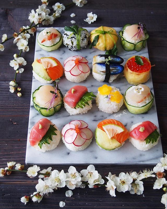 """日本語⬇️ Today's Homemade Temari-Sushi. Temari means """"hand ball """", a traditional embroidered ball. I made with Ootoro : fatty Tuna , Tai : Sea bream , Ikura : Salmon roe , Salmon , Hotate : scallop and some Japanese veggies pickles. I added same plum blossom as yesterday. I really love this flower ☺️ can't wait to have spring soon ! . .  今日の手まり寿司。食材は、トロ、鯛、ホタテ、イクラ、サーモンと野菜(浅漬け)です。 作ろうと思ってたデザインを作るのを忘れていて、終わった後で気が付きました。。 次にしよう、、 料理始める前にノートへ企画書(私が仕事でやってるような)みたいに書かないといけないかもね、物忘れの激しい年頃。。。 25thFeb16"""