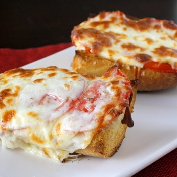 I hope that you can see by the pictures just how good this bread is. When you combine a fresh loaf of french bread, ripe summer tomatoes, and melted mozzarella cheese, it is pretty much a recipe for perfection!