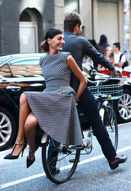 So, the lady whose dress I admired before? Her name is Giovanna Battaglia, and she can also ride a bike backwards, apparently. And in heels. ;)