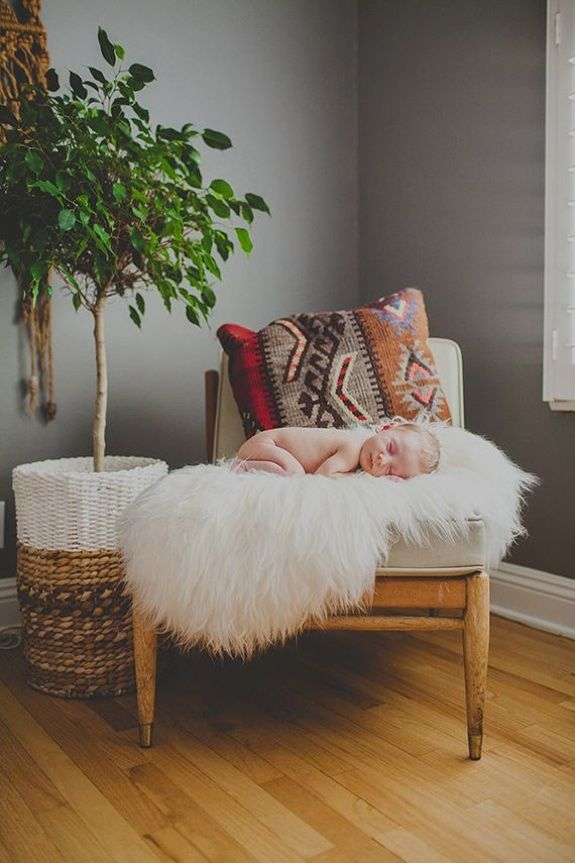 Who needs a glider when you have a cozy chaise with a faux sheep skin throw? This little babe looks like he's gotten used to this vibe just fine ;)