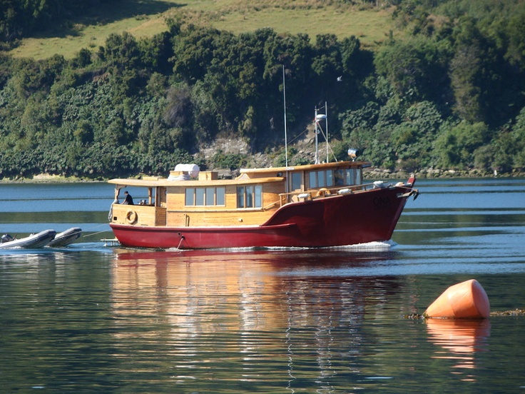 Red boat on Chiloe´s sea