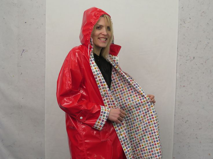 CQ Staffer Karen wears an NYC Boutique Raincoat with New York Subway Dots in White print lining the interior.