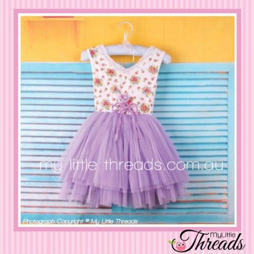 Floral Purple Tutu Dress Floral bodice with a purple lace up and tulle skirt. Perfect for a day out at the park or running around the house causing mischief.