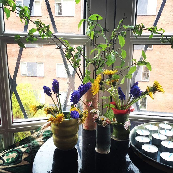 Different homemade ceramic vases with wildflowers