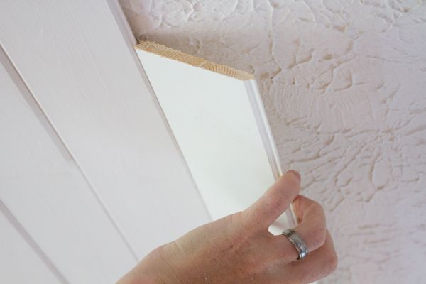 Popcorn Ceiling To Plank Ceiling | The Lettered Cottage.  For a pack of six, 8' long planks, at Lowe's:  Eleven dollars.  Each pack of planks covers 14 square feet.  *use to cover ugly ceiling in half bath!