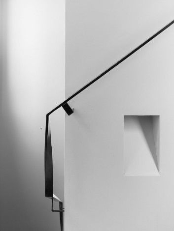 Nice thin profile - would just do the support vertically, not at an angle, as shown...  B.E custom wall light and thin black steel handrail at Canterbury Road Apartments, Toorak
