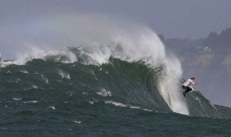 (AP) — The Latest on Northern California's big-wave surfing competition known as Titans of Mavericks (all times local):  Lamb of nearby Santa Cruz, California outlasted 23 other competitors to win the 10th organized contest at the legendary Mavericks surf break near Half Moon Bay, about 20 miles south of San Francisco.  Elite surfers are riding huge waves off the coast of Northern California as the big-wave surfing competition known as the Titans of Mavericks gets underway Friday.  The…