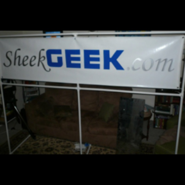 Custom PVC banner stand for under $20. I made one for work with a modified version of this design. I attached the banner to the frame using cheap shower curtain hooks and zip ties.   http://sheekgeek.org/2010/adamsheekgeek/custom-pvc-banner-holder-for-about-15