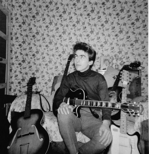 "beatlebob64:  all-about-history:  George at home in Upton Green, Speke, Liverpool. 1961. ""When we started making a bit of money I saved up seventy-five pounds and I saw an ad in a paper in Liverpool, and there was a guy going to sell this guitar he'd brought back from America, and I went and night it. It was a Gretsch, the Duo Jet, which is on my Cloud Nine album cover. It was my first real American guitar. I tell you, it was second-hand but I polished that thing, and I was so proud to own…"
