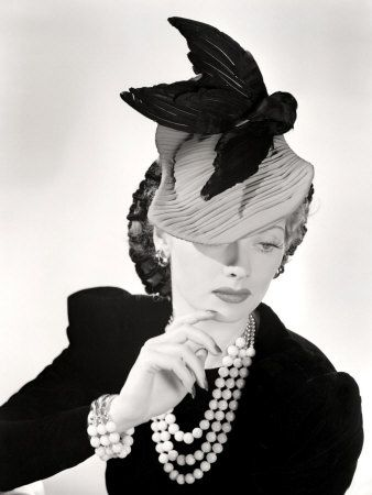 Lucille Ball modelling a killer hat