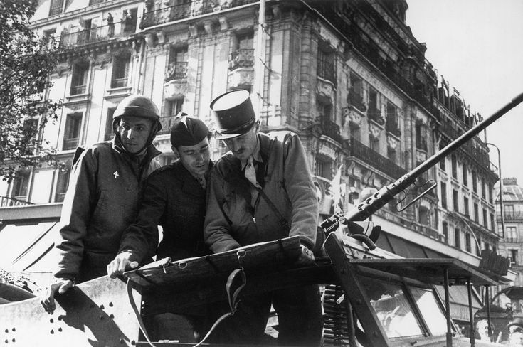 Paris. 25th August 1944. The French liberation Forces of the 2nd Armored Division were headed by General Leclerc, he is seen here entering Paris upon the liberation//Robert Capa